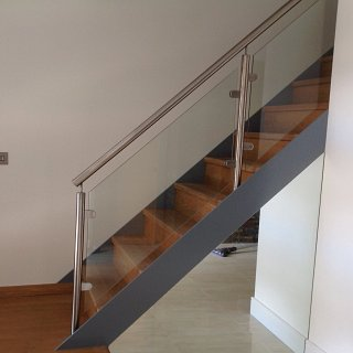 Complete staircase with stainless handrail, steel stringers and solid oak treads