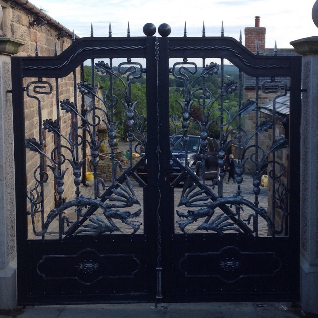 Beautiful hand crafted wrought iron dragon gates