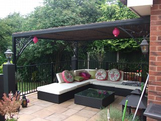 Decorative garden canopy, wrought iron corner braces